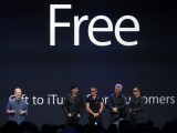 Apple CEO Tim Cook (L) stands with Irish rock band U2 as he speaks during an Apple event announcing the iPhone 6 and the Apple Watch at the Flint Center in Cupertino, California, September 9, 2014. REUTERS/Stephen Lam (UNITED STATES - Tags: BUSINESS SCIENCE TECHNOLOGY ENTERTAINMENT) - RTR45LHJ